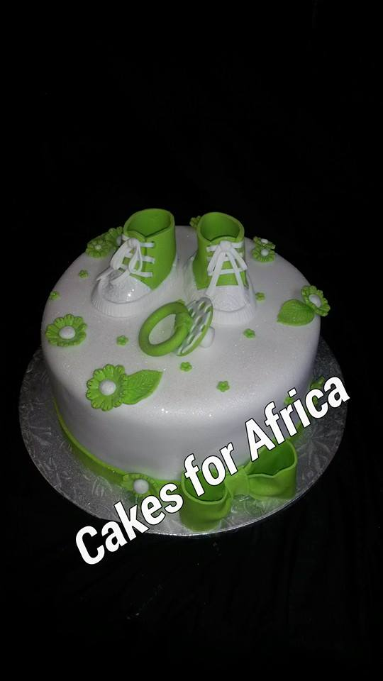 chc027--green-and-white-dummy-and-booties-on-round-cake
